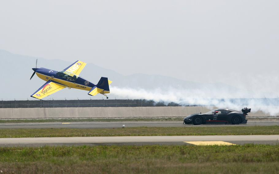 Pilot Masahiro Utsumi, also known as Whiskey Papa, races against a car during Friendship Day 2019 at Marine Corps Air Station Iwakuni, Japan, Sunday, May 5, 2019.
