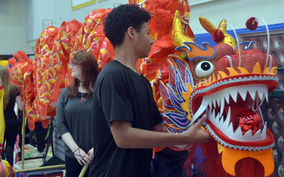 Yokota High School students prepare for a performance during their Asian American Pacific Islander Heritage Month celebration at the air base in western Tokyo, Monday, May 6, 2019.