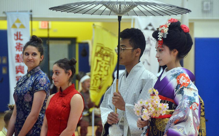 Students wear traditional clothing during the Asian American Pacific Islander Heritage Month celebration at Yokota Air Base, Japan, Monday, May 6, 2019.