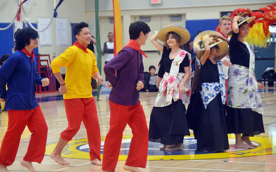 High schoolers perform a Philippine hat dance during an Asian American Pacific Islander Heritage Month celebration at Yokota Air Base, Japan, Monday, May 6, 2019.