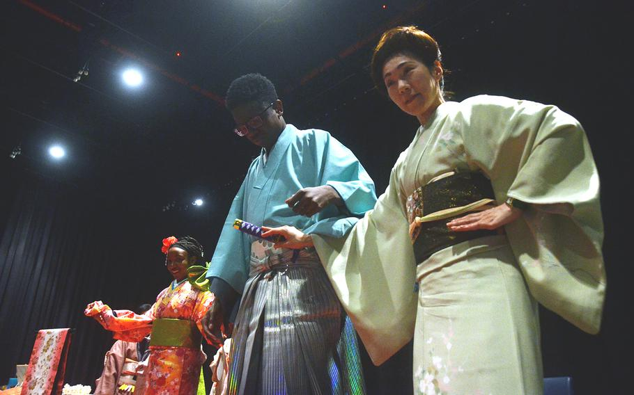 Students and volunteers show off traditional Japanese clothing during the Asian American Pacific Islander Heritage Month celebration at Yokota Air Base, Japan, Monday, May 6, 2019.