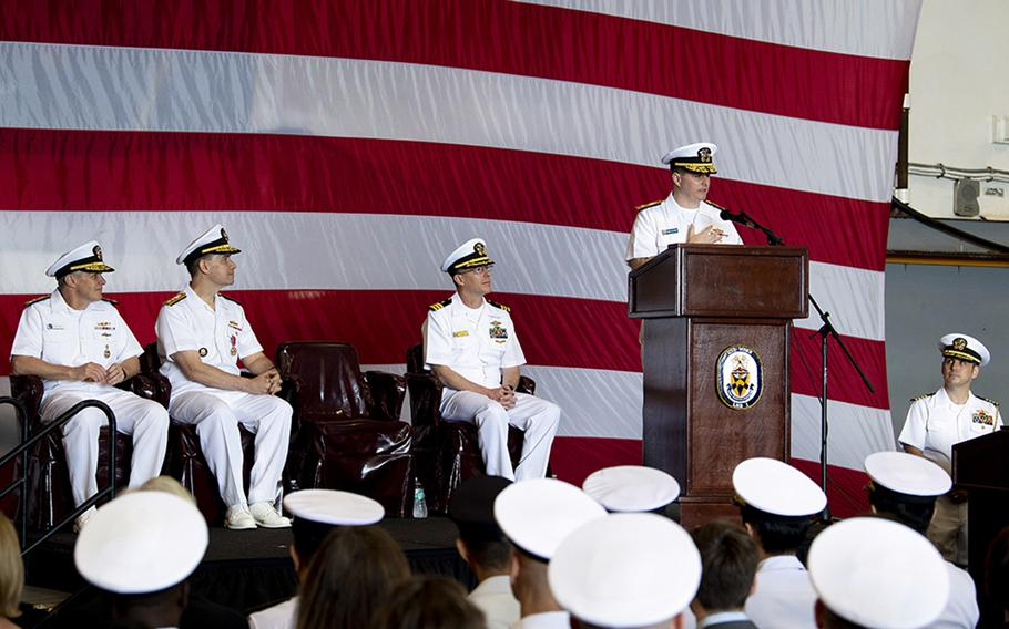 Rear Adm. Fred Kacher addresses his sailors after assuming command of the amphibious force for 7th Fleet from Rear Adm. Brad Cooper aboard the USS Wasp at Sasebo Naval Base, Japan, May 17, 2019.
