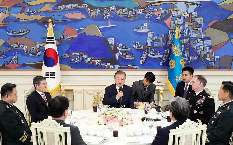 South Korean President Moon Jae-in, center, meets with U.S. Forces Korea commander Gen. Robert Abrams and other military leaders at the presidential palace in Seoul, South Korea, Tuesday, May 21, 2019.
