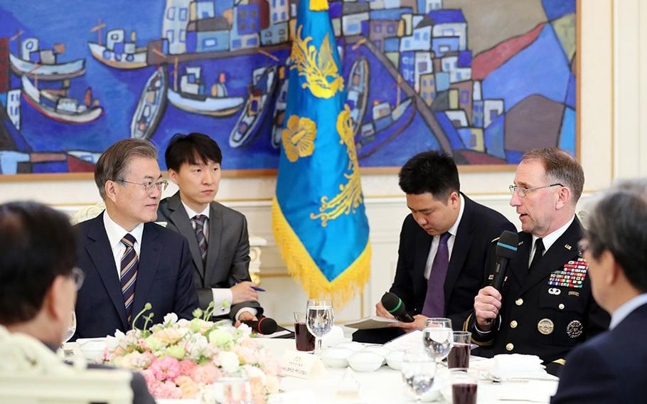 South Korean President Moon Jae-in meets with U.S. Forces Korea commander Gen. Robert Abrams and other military leaders at the presidential palace in Seoul, South Korea, Tuesday, May 21, 2019.