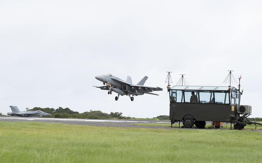 F/A-18s from Carrier Air Wing 5 at Marine Corps Air Station Iwakuni, Japan, take part in field carrier-landing practice at Iwo Jima, Japan, May 17, 2019.