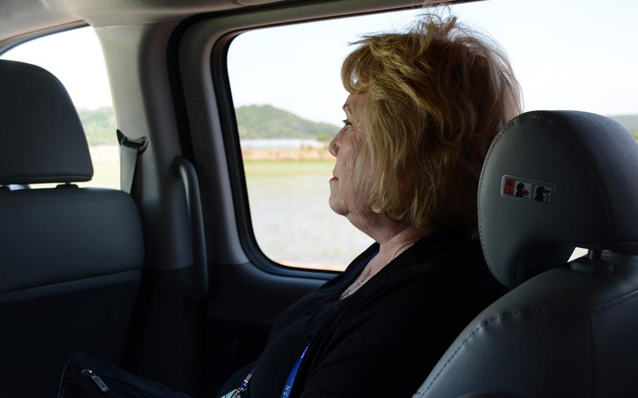 Judith Britton of Hobbs, N.M., joined other relatives of missing American servicemembers in a visit to the Korean War battleground known as Arrowhead Hill, May 29, 2019, for a rare view of the site in the Demilitarized Zone where South Korea is searching for remains.