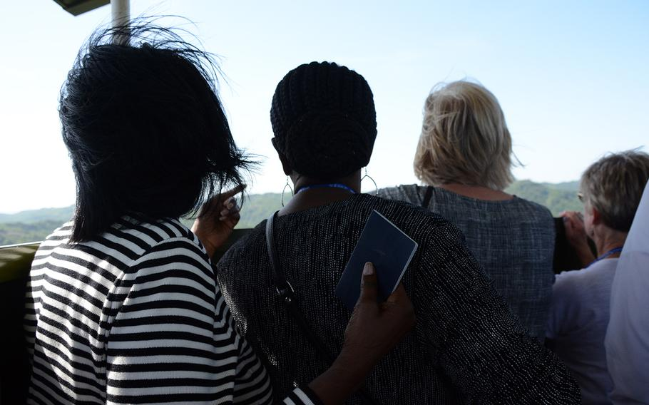 Relatives of missing American servicemembers look out at an area where South Koreans are excavating for remains during a rare visit to the Korean War battleground known as Arrowhead Hill in the Demilitarized Zone, May 29, 2019.