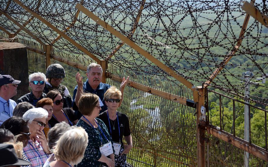 Relatives of American servicemembers who remain missing from the 1950-53 Korean War get a briefing on remains recovery efforts during a visit to the former battleground known as Arrowhead Hill in the Demilitarized Zone, May 29, 2019.