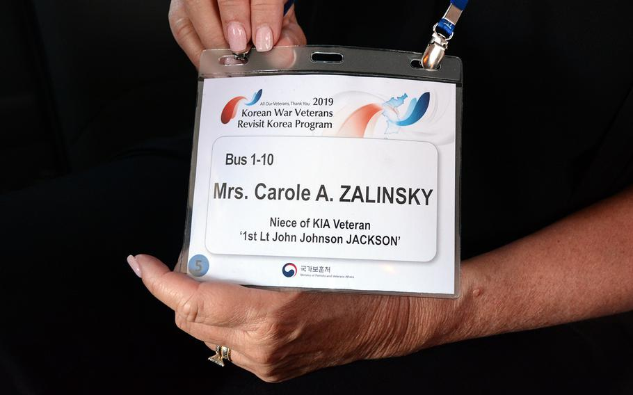 Carole Zalinksky of Clark, N.J., displays a nametag showing that she is the niece of Air Force 1st Lt. John Johnson Jackson, who was shot down over North Korea in 1950. She joined other relatives of missing U.S. servicemembers in a visit to the former Korean War battleground known as Arrowhead Hill, May 29, 2019.