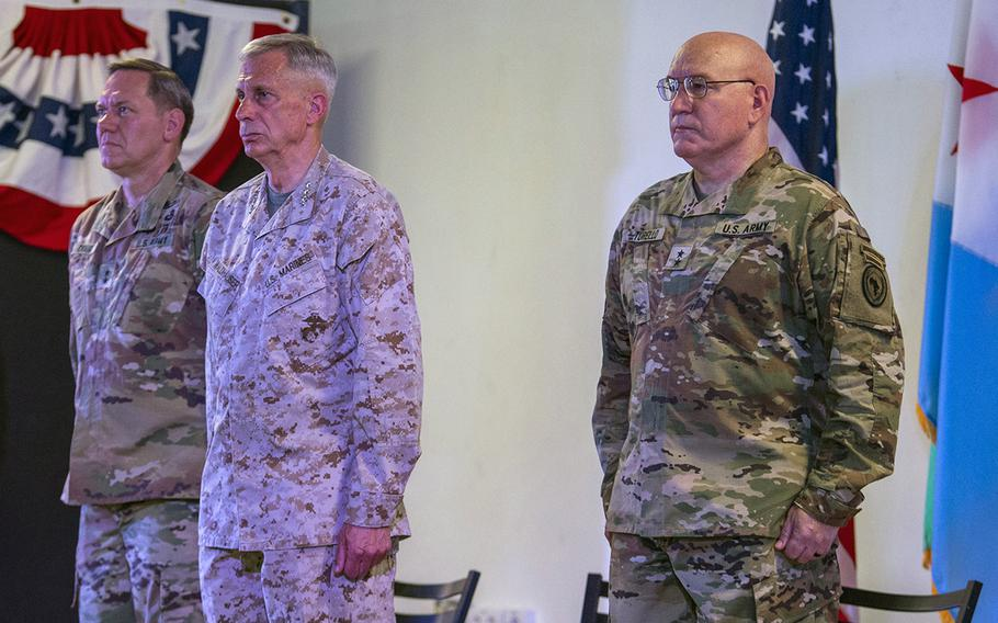 U.S. Marine Corps Gen. Thomas Waldhauser, commander of U.S Africa Command, middle, presides over a change of command ceremony transferring authority of Combined Joint Task Force-Horn of Africa from U.S. Army Maj. Gen. James D. Craig, left, to U.S. Army Maj. Gen. Michael D. Turello at Camp Lemonnier, Djibouti, June 12, 2019.