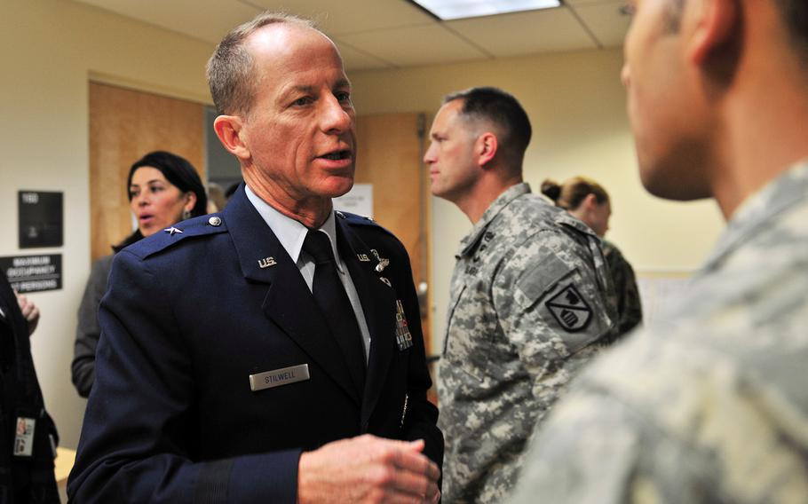 Then-Air Force Brig. Gen. David Stilwell offers advice to a newly minted foreign area officer during a conference at the Defense Language Institute Foreign Language Center in Monterey, Calif., Jan. 14, 2014.