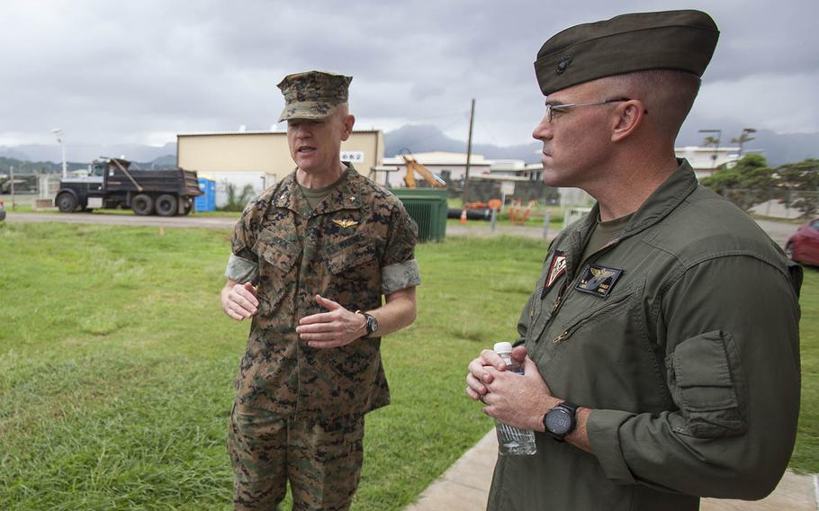 Then-Brig. Gen. Paul Rock Jr., left, commander of Marine Corps Installations Pacific, and Lt. Col. Nathaniel Baker, commander of Marine Corps Air Station Kaneohe Bay, speak outside the base's air traffic control tower, Oct. 15, 2018.
