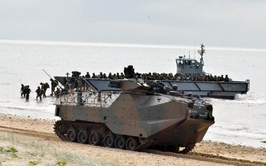 Members of Japan's Amphibious Rapid Deployment Brigade come ashore near Bowen, Australia, during Talisman Sabre 2019 on Monday, July 22, 2019.