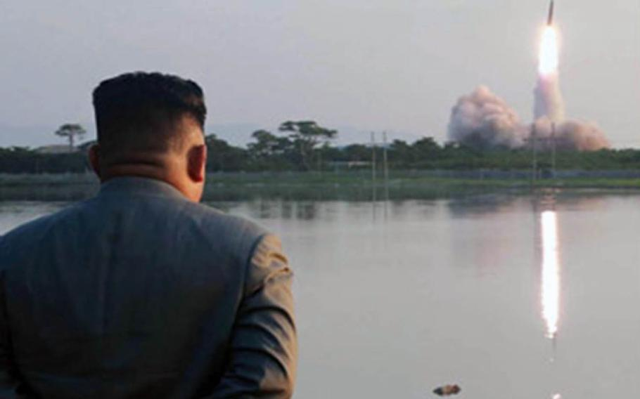 North Korean leader Kim Jong Un watches a missile launch in this undated photo released by the Korean Central News Agency, Friday, July 26, 2019.