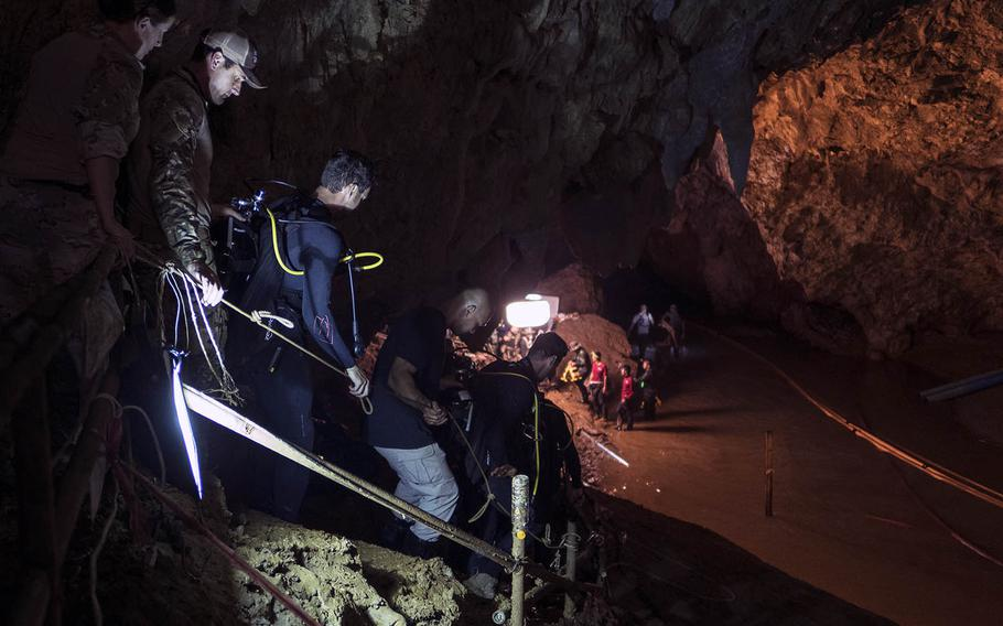 Air Force Tech Sgt. Kenny O'Brien, third from left, descends into Tham Luang cave in Chiang Rai, Thailand, ahead of dive operations on July 2, 2018.