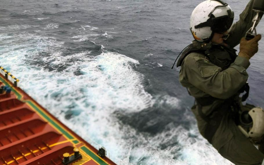 Petty Officer 2nd Class Nathan Swartz of Helicopter Sea Combat Squadron 25, Guam, descends onto the CSC Brave to help a crewmember in distress on Tuesday, Aug. 6, 2019.