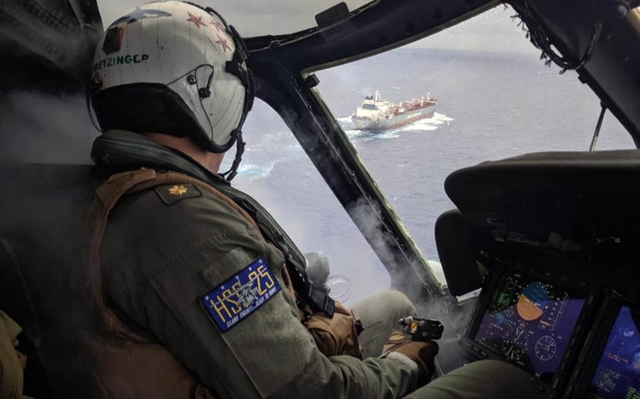 Lt. Cmdr. Philip Pretzinger approaches a Chinese oil tanker for a medical evacuation mission by the Guam-based Helicopter Sea Combat Squadron 25 on Tuesday, Aug. 6, 2019.