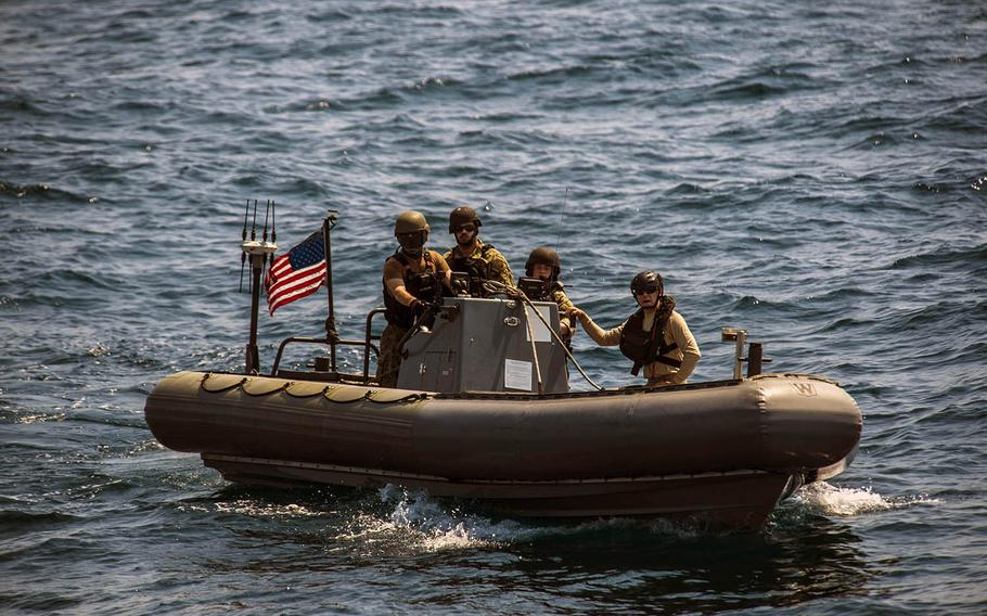Sailors from USS Montgomery conduct a visit, board, search and seizure exercise in the Java Sea as part of Cooperation Afloat Readiness and Training Indonesia on Aug. 6, 2019.