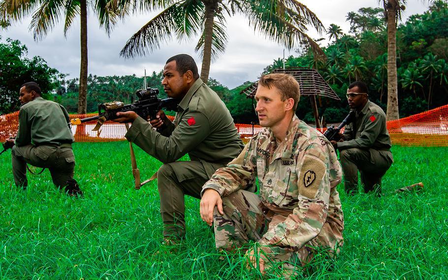Army Staff Sgt. Clinton Danforth trains with his Fijian army counterparts in Savusavu, Fiji, Aug. 3, 2019.