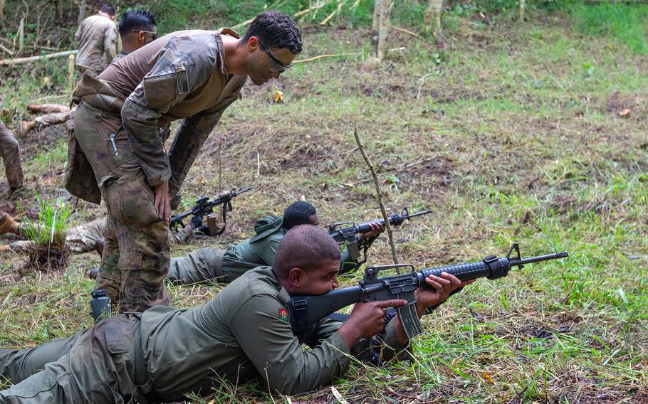 Army Sgt. Tanner Bianchi observes a Fijian soldier during training in Labasa, Fiji, July 31, 2019.