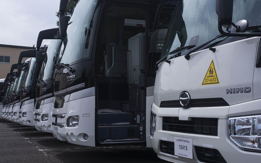The Department of Defense Education Activity in Japan is rolling out new touring-style school buses at its schools on the main islands. The buses are shown here at Yokota Air Base on Aug. 16, 2019.