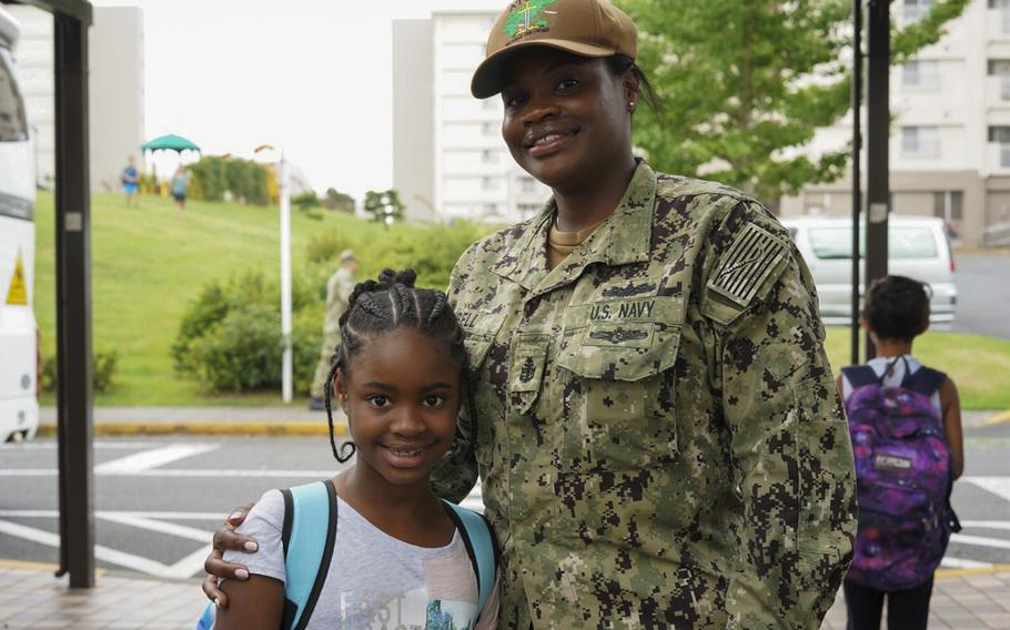 Senior Chief Petty Officer Cleopatra Bell poses outside Sullivans Elementary School with her daughter, third-grader Jazlyn Bell, at Yokosuka Naval Base,Japan, Monday, Aug. 26, 2019.