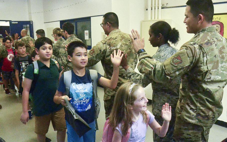 Airmen from the 374th Medical Group greet children at Joan K. Mendel Elementary School on Yokota Air Base, Japan, Monday, Aug. 26, 2019.