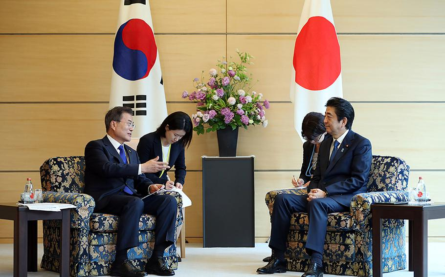 South Korean President Moon Jae-in, left, meets with Japanese Prime Minister Shinzo Abe in May 2018 before relations between the neighboring countries deteriorated this year.