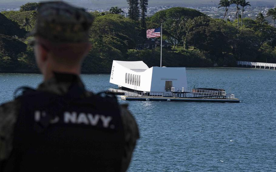 A sailor stands watch as the USS Boxer passes the USS Arizona Memorial in Pearl Harbor, Hawaii, May 16, 2019.