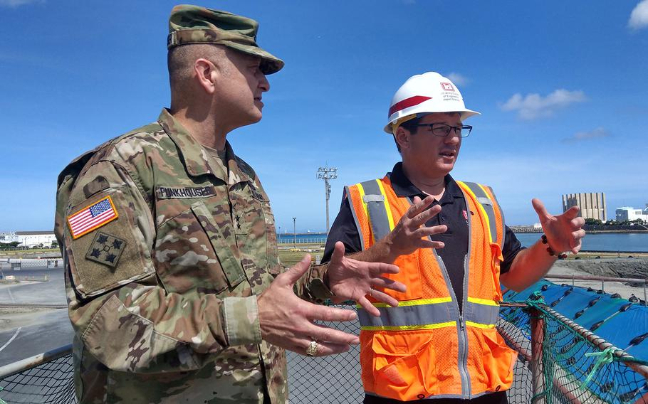 Maj. Gen. Anthony Funkhouser, left, U.S. Army Corps of Engineers deputy commander, checks out the dredging of a military port in Naha, Japan, August 29, 2019.