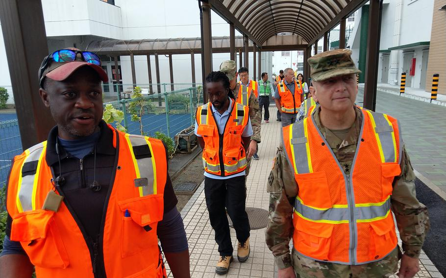 Engineer Donald George, left, gives U.S. Army Corps of Engineers deputy commander Maj. Gen. Anthony Funkhouser a tour of a Department of Defense Education Activity project at Sasebo Naval Base, Japan, in this undated photo.