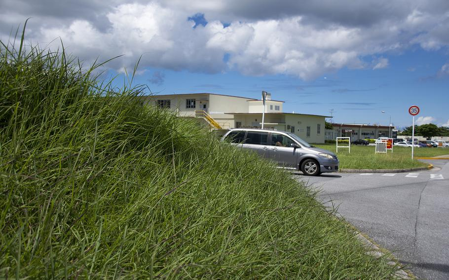 High grass continues to grow near facilities at Camp Foster, Okinawa, Aug. 30, 2019.