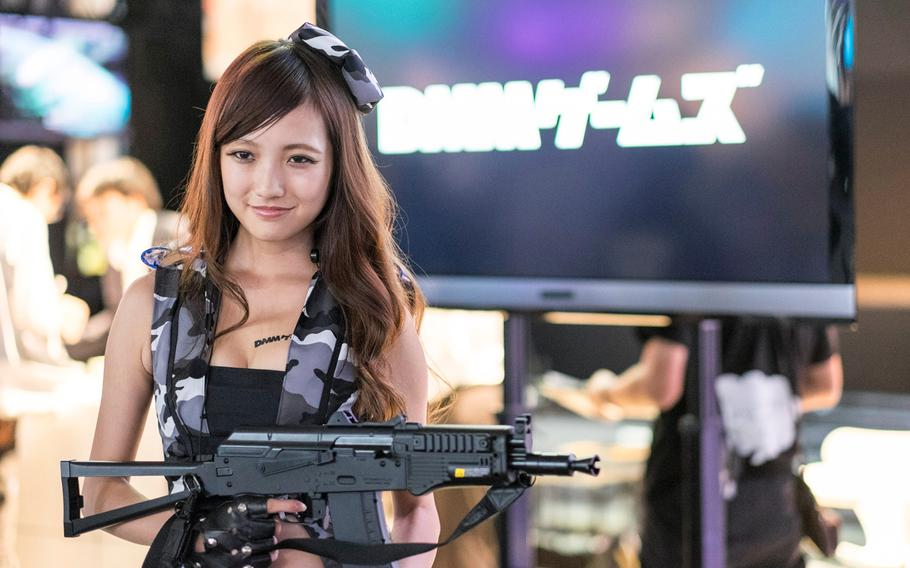 A cosplay actress for DMM.com poses during a past Tokyo Game Show in Makuhari, Japan.