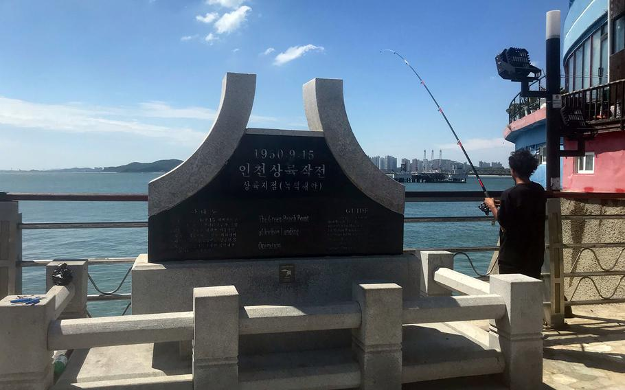 A South Korean fisherman casts his line near a Green Beach memorial marking the site where the 5th Marines first came ashore on Sept. 15, 1950.