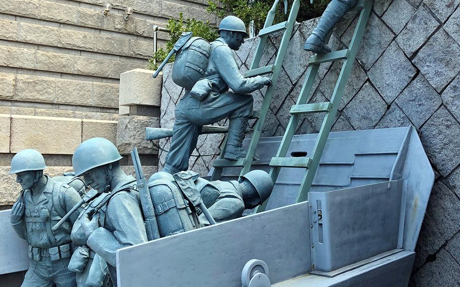 A sculpture depicting the Marines scaling a seawall at the landing point known as Red Beach during the September 1950 Incheon landing is among the displays at a museum devoted to the pivotal operation in South Korean port city.