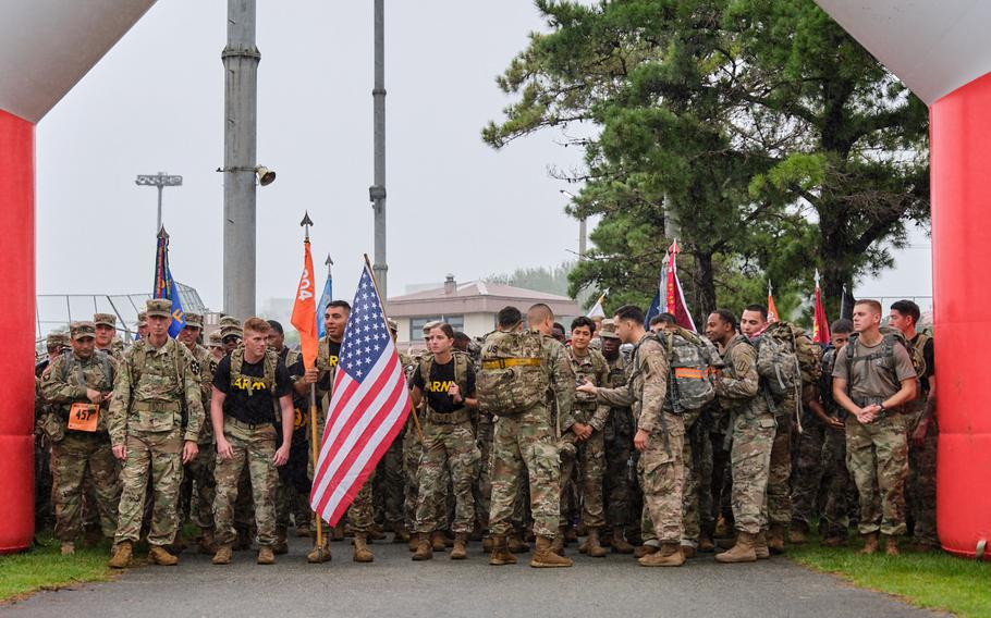 Soldiers wait at the starting line during the ninth annual 9/11 Memorial Ruck March at Camp Humphreys, South Korea, Wednesday, Sept. 11, 2019.