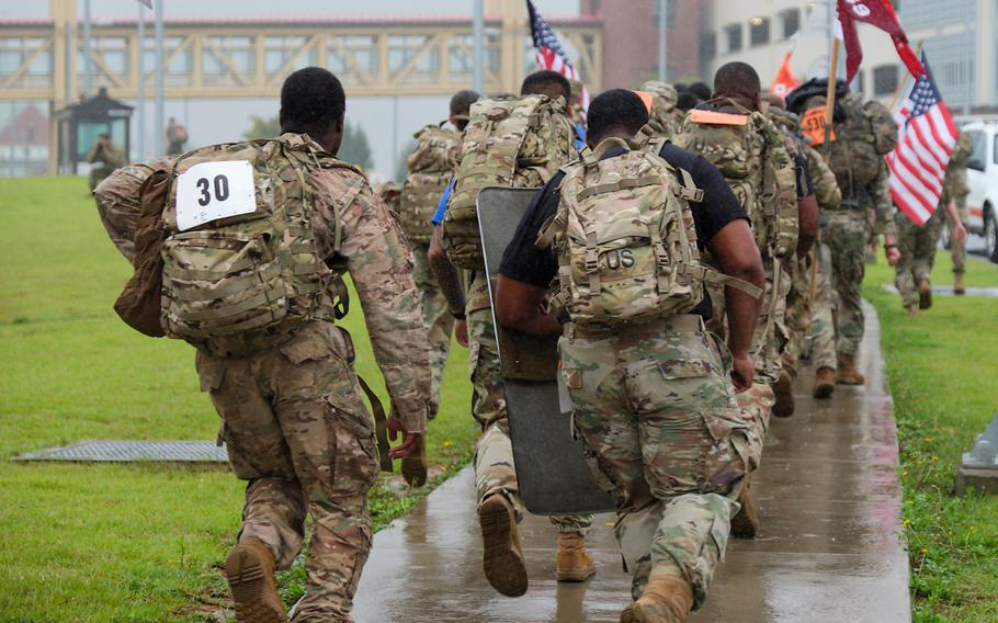 Soldiers from across South Korea participate in the 9/11 Memorial Ruck March at Camp Humphreys, South Korea, Wednesday, Sept. 11, 2019.