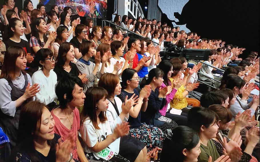 """A studio audience listens to a group from the U.S. Air Force Band of the Pacific during a live broadcast of the Japanese TV show, """"Nodojiman The World!"""" in Tokyo on Wednesday, Sept. 11, 2019."""