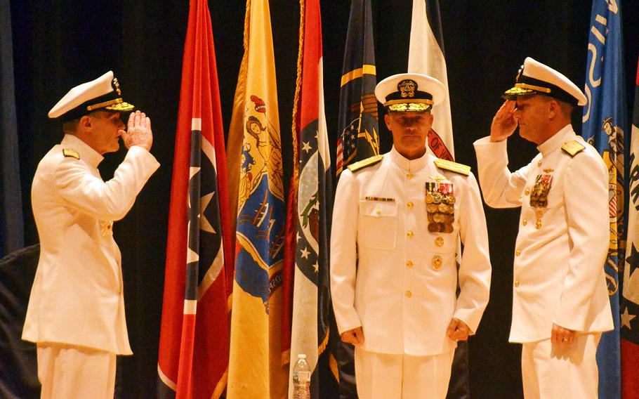 Outgoing 7th Fleet commander Vice Adm. Phillip Sawyer, left, salutes his replacement, Vice Adm. Bill Merz, far right, during their change-of-command ceremony at Yokosuka Naval Base, Japan, Thursday, Sept. 12, 2019. Pacific Fleet commander Adm. John Aquilino stands between them.