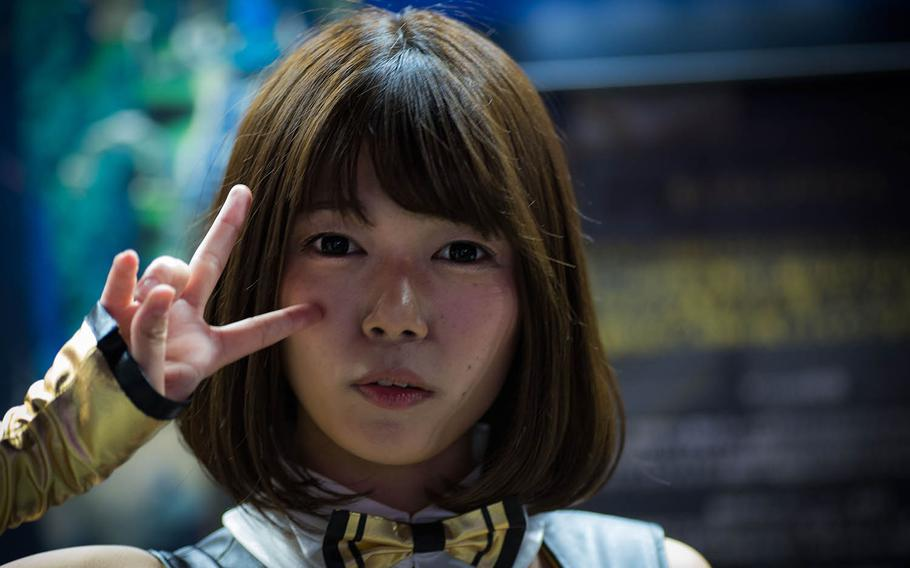 A cosplay model stands in front of a vendor booth at the Tokyo Game Show on Thursday, Sept. 12, 2019.