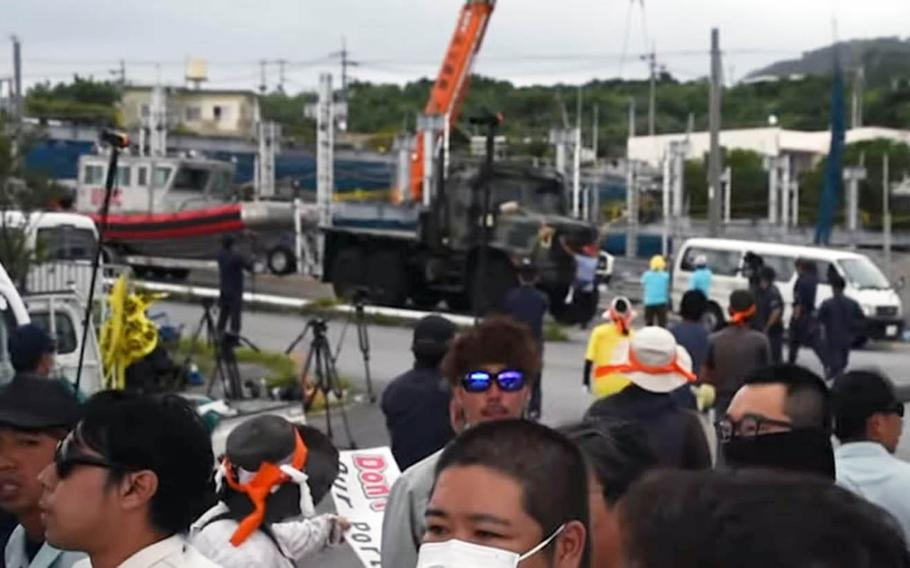 A screenshot from a YouTube video shows demonstrators gathered to oppose the Marine Corps launching a small craft from Motobu Port on Okinawa, Japan, on Tuesday, Sept. 18, 2019.
