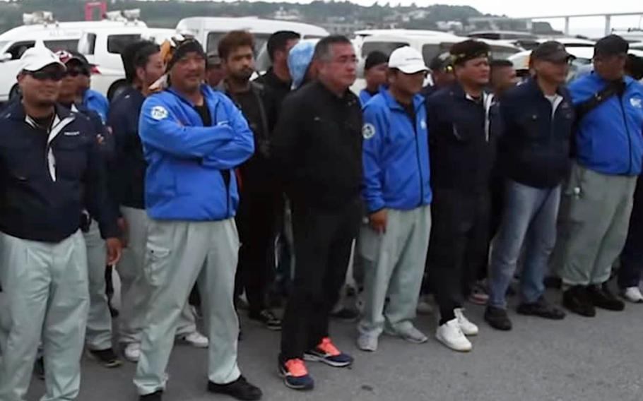 A screenshot from a YouTube video shows protesters opposed to the Marine Corps launching a small craft from Motobu Port on Okinawa, Japan, facing the truck hauling the boat on Tuesday, Sept. 17, 2019.