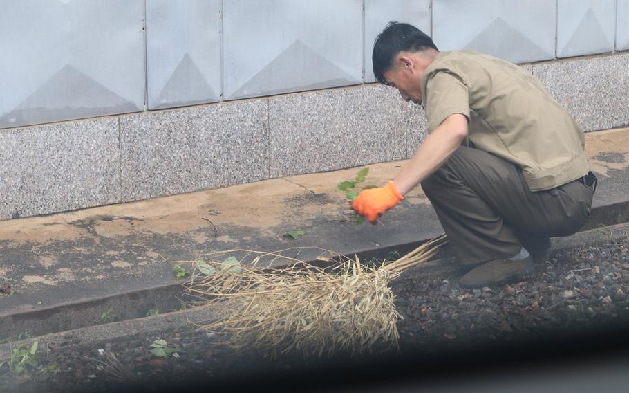 North Korean soldiers and workers repaired typhoon damage at the Joint Security Area on the border from Sept. 12-14, 2019.