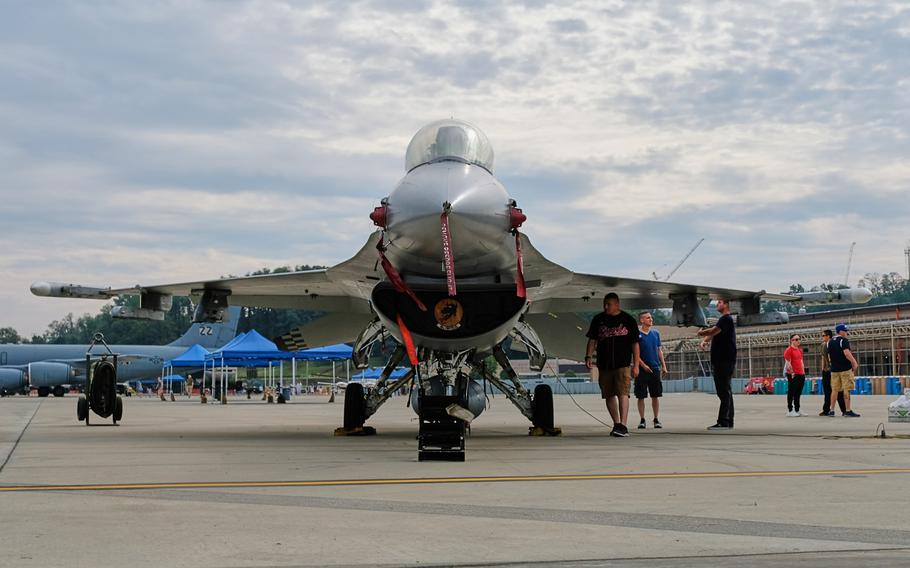 Visitors check out an F-16 Fighting Falcon during Air Power Day at Osan Air Base, South Korea, Friday, Sept. 20, 2019.