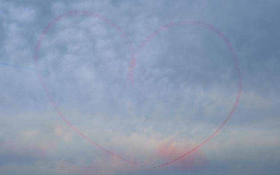 Members of South Korea's Black Eagles aerobatics team draw a pierced heart in the sky during Air Power Day at Osan Air Base, South Korea, Friday, Sept. 20, 2019.