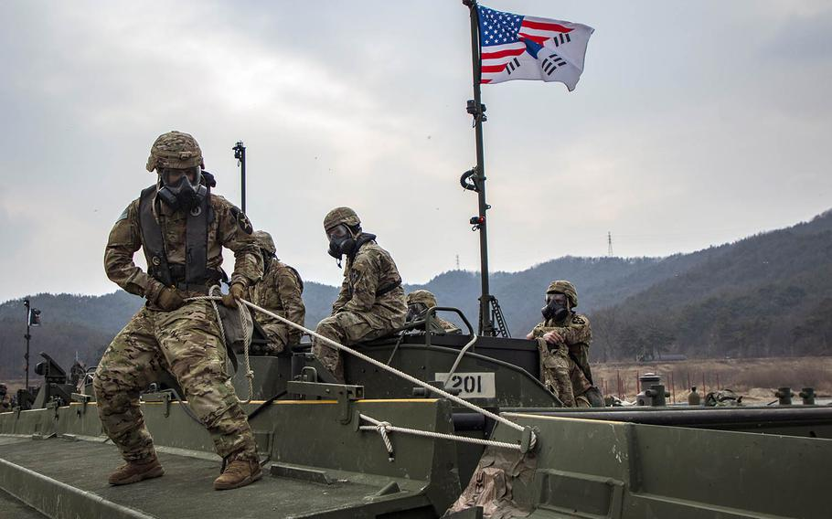U.S. soldiers of the 2nd Infantry Division Sustainment Brigade connect a bridge section during a rafting exercise on Namhan River, South Korea, on Feb. 27, 2019.