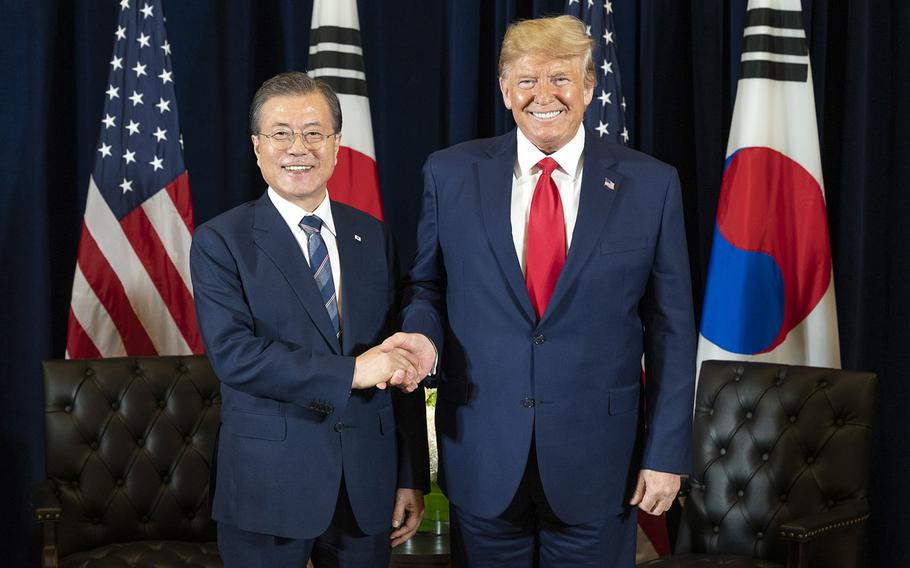South Korean President Moon Jae-in and President Donald Trump pose on the sidelines of the United Nations General Assembly in New York, N.Y., Monday, Sept. 23, 2019.