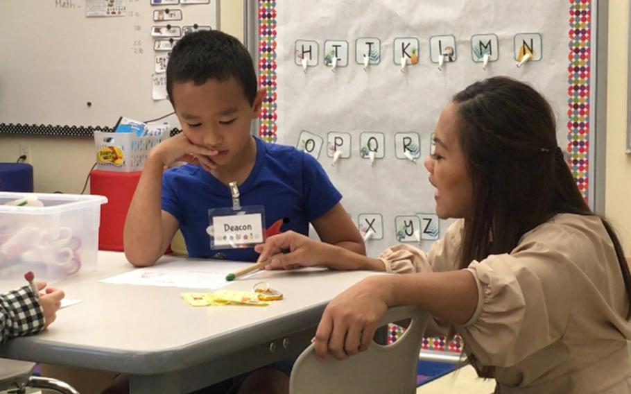 A student receives one-on-one attention at Sasebo Elementary School on Sasebo Naval Base, Japan, Wednesday, Sept. 25, 2019.