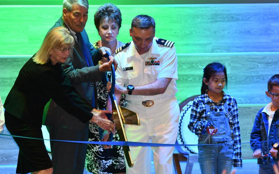 From left, DODEA Pacific East superintendent Judith Allen; DODEA director Thomas Brady; DODEA Pacific director Lois Rapp; and Sasebo Naval Base chief of staff Cmdr. Douglas Kennedy cut the ribbon for a $57 million elementary school, Wednesday, Sept. 25, 2019.