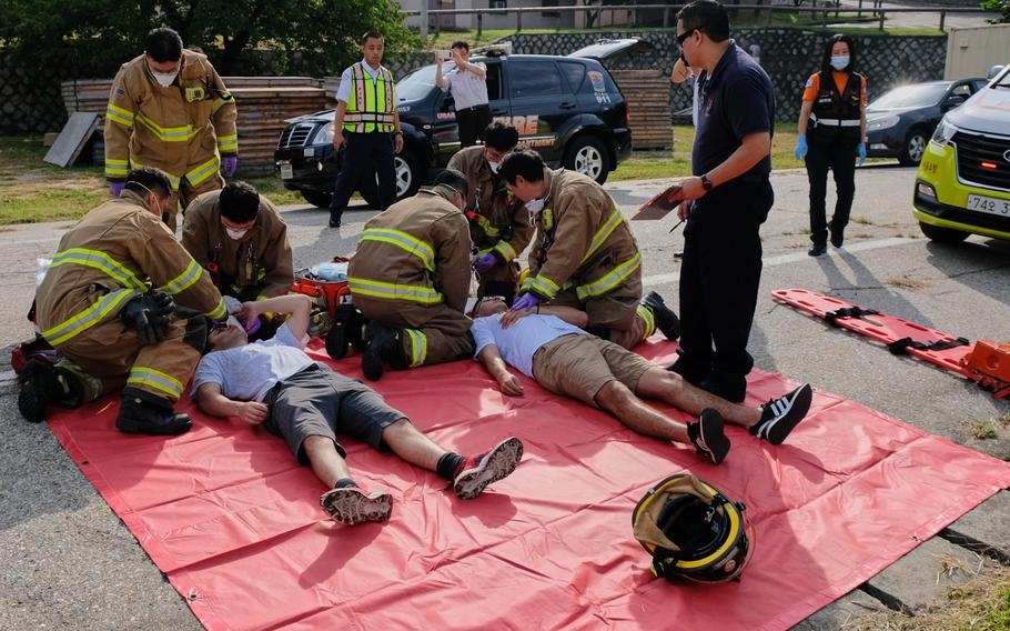 Firefighters from the U.S. Army Garrison Yongsan Fire Department treat role-players for knife wounds during a training exercise on the base in South Korea on Thursday, Sept. 26, 2019.